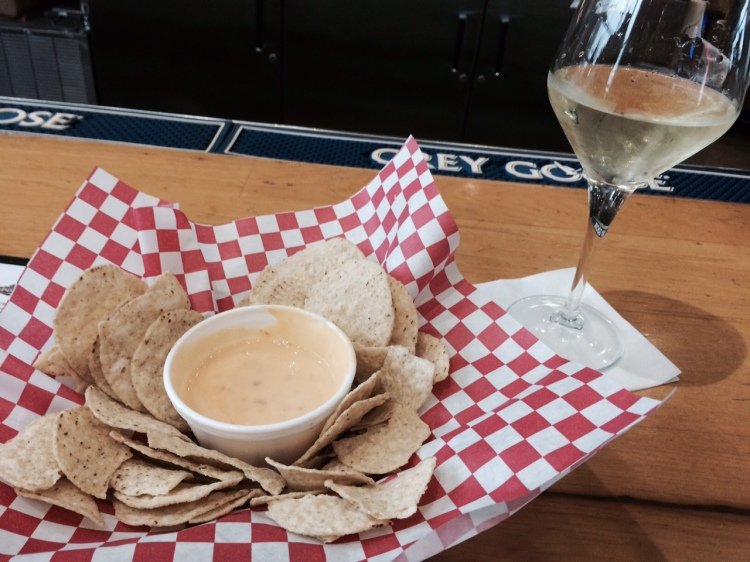 Last meal in Texas. Surprisingly decent queso at Bergstrom Airport's fancy Earl Campbell's Sports Bar.