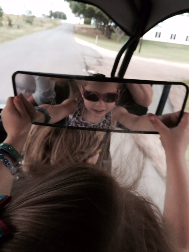 But it was still a good idea to check for cars in the rearview mirror. Molly was mostly checking out how awesome she looks in sunglasses.