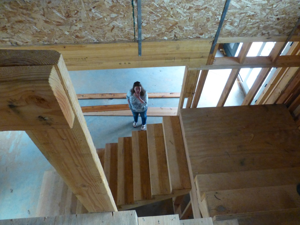 Mom downstairs at the job site. Dad and Tohner (Artisan Builders) are building a 10,000 square foot house.